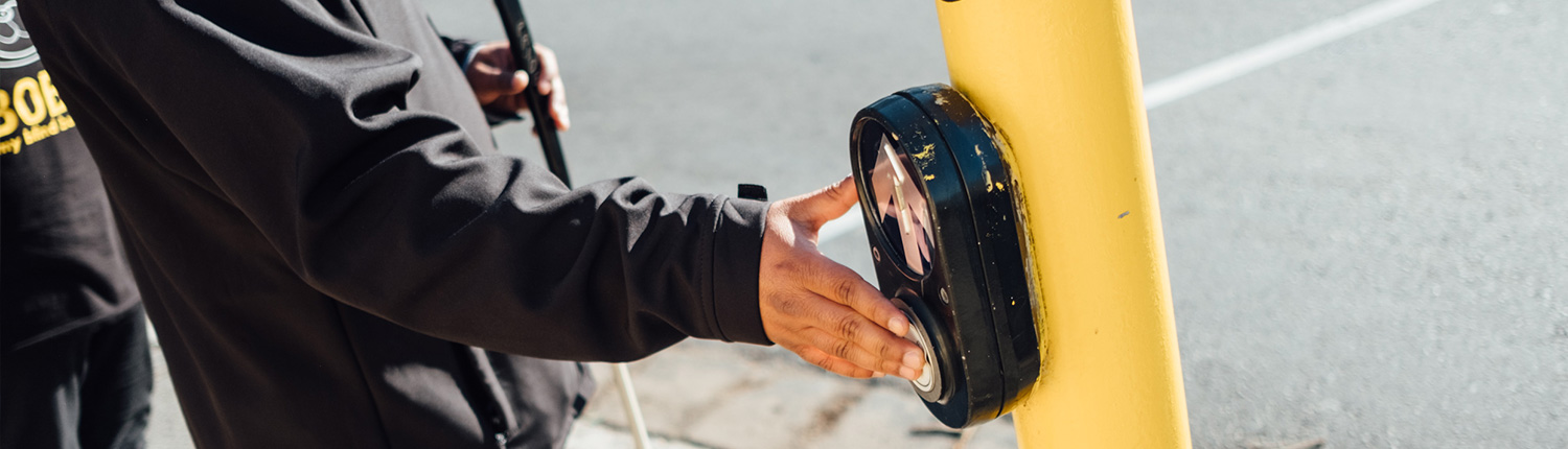 A LOFOB client pressing a crosswalk button